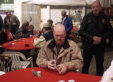 Benny Pince (cq), forground, of Palmer Lake focuses on the poker game at hand as Monument Police...