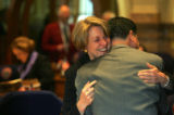 Colorado State Senator Deanna Hanna hugs Senator Abel Tapia on her last day at the Capitol in...