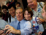 07/27/2004 Boston-Vermont governor Howard Dean poses for a pictiure with a fan's camera as he...