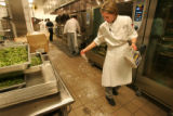 Cheryl Scantlebury (cq), the executive chef of the new Hyatt, sprinkles a powder on the floor to...