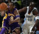 JPM144  Los Angeles Lakers Kobe Bryant, #8, beats Denver Nuggets Ruben Patterson, #22, to a loose...