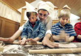 Shmuel Engel (cq) wearing chef hat, from the Chabad of Colorado in Denver, helps first graders ...