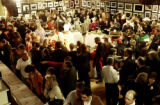 Many turn out for a photography auction to benefit Rocky Mountain News photographer Steven R....