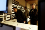 David Greenberg, cq, and Tom Cole, cq, look at photographs during a auction to benefit  Rocky...