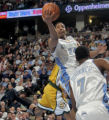 Denver Nuggets guard Andre Miller, drives to the basket in the fourth quarter of play against the...
