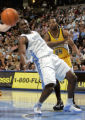 Denver Nuggets forward Reggie Evans, left, boxes out former teammate Chris Wilcox, right, of the...