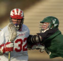Denver East High School's Patrick Murray (cq), #32, repels a push from Fort Collins High School's...
