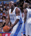 Denver Nuggets guard Ruben Patterson,right, argues a foul called on him in the first quarer of...