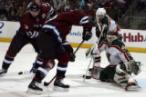 DXA111 - Colorado Avalanche right winger Milan Hejduk, background left, of the Czech Republic,...