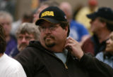 Brian Rasmussen (cq), a RTD mechanic for 9 years, listens to questions presented at a union...