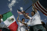 Carrying American flags Mario Tovar, (cq) (r) and Salvador Bravo (cq) (l) both of Grand Junction...