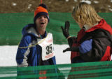 Scott Hill, of Boulder, is congratulated after finishing the Snowshoe One Kilometer Unified Sports...