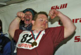 Dori Einbeck, left, enjoys Jeremy Wade, from Parker, as he celebrates his gold medal in the Cross...