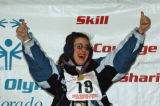 Lynn A. Horton, from Colorado Springs, celebrates her gold medal in the Cross Country One...