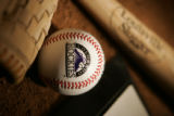 (DENVER, Co. - SHOT 3/29/2005) Photo of home plate, a baseball, a glove and a bat for the cover of...