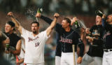 Padres.CammiChampagne.Sept12,1998,-- Trevor Hoffman pours champagne on Ken Caminiti on the mound...