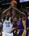 JPM266  Los Angeles Lakers William Parker, #1, fouls Denver Nuggets Andre Miller, #24, in the...