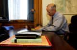 With a military issued Iraq Transistional Handbook on his desk, Colorado State Treasurer Mike...