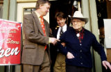 Jack A. Weil, right, founder of Rockmount Ranchwear, is lead by Mayor John Hickenlooper, left, and...