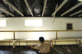 Inmate Jose Tovar (CQ), 21, cleans the fish hatcheries at the East Canon City Complex of Colorado...