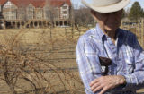 Arlo Smith (CQ), of Canon City, stands in the vineyards of The Winery Holy Cross Abbey in Canon...