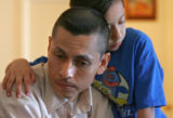 Raul Miranda, CQ, 33, left, is comforted by one of his six children Janeth Miranda. CQ, 8, while...