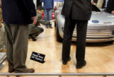 Freelance automotive journalist Isaac Bouchard, cq, Denver, inspects a Ford concept car during a...