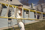 Scott Lawerence, (cq), Colorado Springs, Colo., walks by carring a big ladder readying for another...