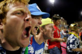 DU lacrosse fans Jock Goodrich, cq, from left, Doug Young, cq, and Drew Doyle cheer from bleachers...