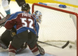 (Denver,CO,Shot On 4/26/04-- Avalanche goalie David Aebischer and defensman Adam Foote watch the...
