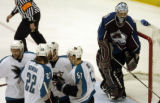 (DENVER, CO - 5/4/04) -- Colorado Avalanche goalie David Aebischer, right, cleans ice from the...