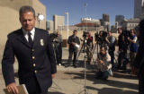 Denver Police Division Chief of Investigations David Fisher(cq) walks away after speaking at a...