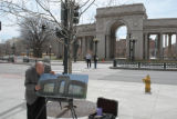 Lakewood artist Keith Johnson(cq) takes advantage of spring weather and sunlight Friday March 31,...