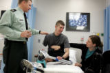 Cpt. Dave Rozelle, cq, left, who has now been promoted to Major, checks 1st Lt. Ryan Kules'...