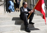 North Denver resident Ben Martinez (cq) sits on the steps of the Cathedral of the Immaculate...