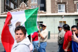 Sister Molly Munos (cq), left, and Rosalio Campos Santos (cq) carry the Mexican flag during a...