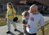 Laura Sirhal, cq, and her husband Jim, cq, Denver,  pick up their son Quintin, 5, from school on...