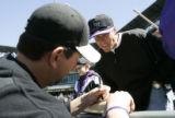 The Colorado Rockies first baseman Todd Helton signs his autograph for fan Tony Rizzo (cq) of...