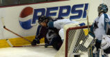 (DENVER, CO - 5/4/04) -- Colorado Avalanche Peter Forsberg, left, struggles for the puck with San...