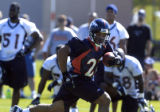 (DOVE VALLEY, Co., SHOT 7/29/2004) Denver Broncos' running back Quentin Griffin (#22), in his...