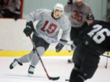 Colorado Avalanche captain Joe Sakic (#19) moves the puck up ice during a scrimmage during the...