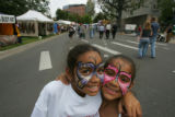 Sisters Maya, 10, and Nezzie Thomas, 7, of Denver, at the Taste of Colorado at Civic Center Park...
