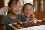 5-year-old twins Leah and Max Kleiner love their grandmother Judy Kleiner's (cq) brisket at Judy's...