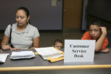 Joana Orbe, (cq), with her sons, Raoul Avila,5, and Jorge Avila, 10, all of denver, wait with all...