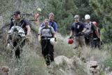 Exhausted searchers end their day of searching in frustration   at a Eldorado Canyon State Park...