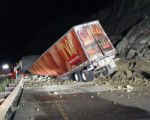 A Semi Truck sits at Mile Marker 58 East Bound on I-70 between Debeque and Grand Junction, along...
