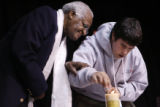MJM4946 The Archbishop Desmond Tutu helps guide the hand of Nick Rosen (cq), of Minnesota as he...