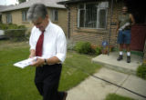 (DENVER, Colo., July 15, 2004)  Mitch Morrissey leaves Maurice Will's house after speaking with...
