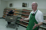 08/16/06 -- Upper Marlboro, Md.  Ken Lee explains how the foodbank operates at the Bishop's...