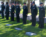 U.S. army honor guard stands at the ready for a 21 gun sulute at a  memorial service for a fallen...
